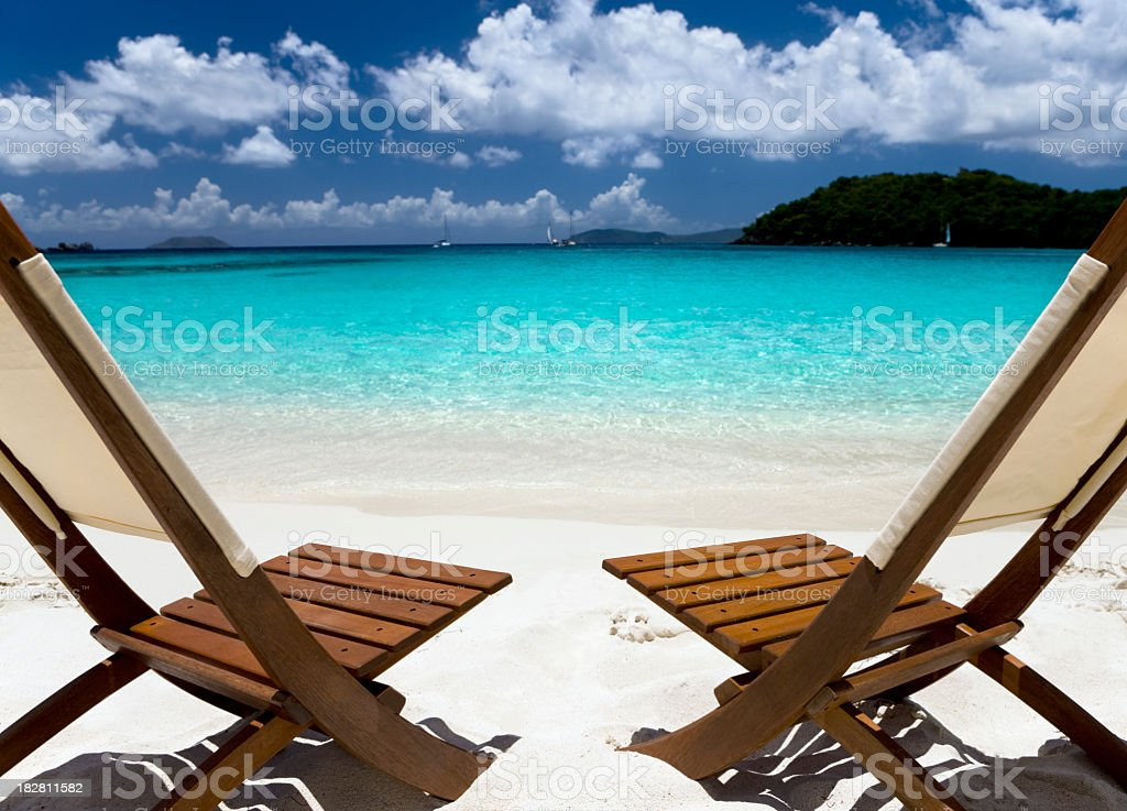 wooden chairs on a beach in the Caribbean royalty-free stock photo