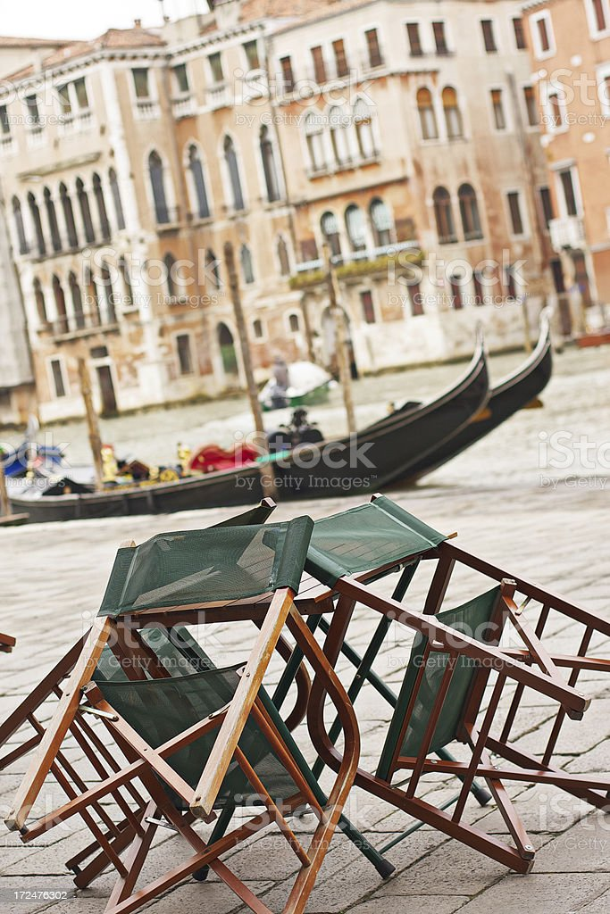 Wooden chairs resting on a table  at Rialto. Venice-Italy royalty-free stock photo