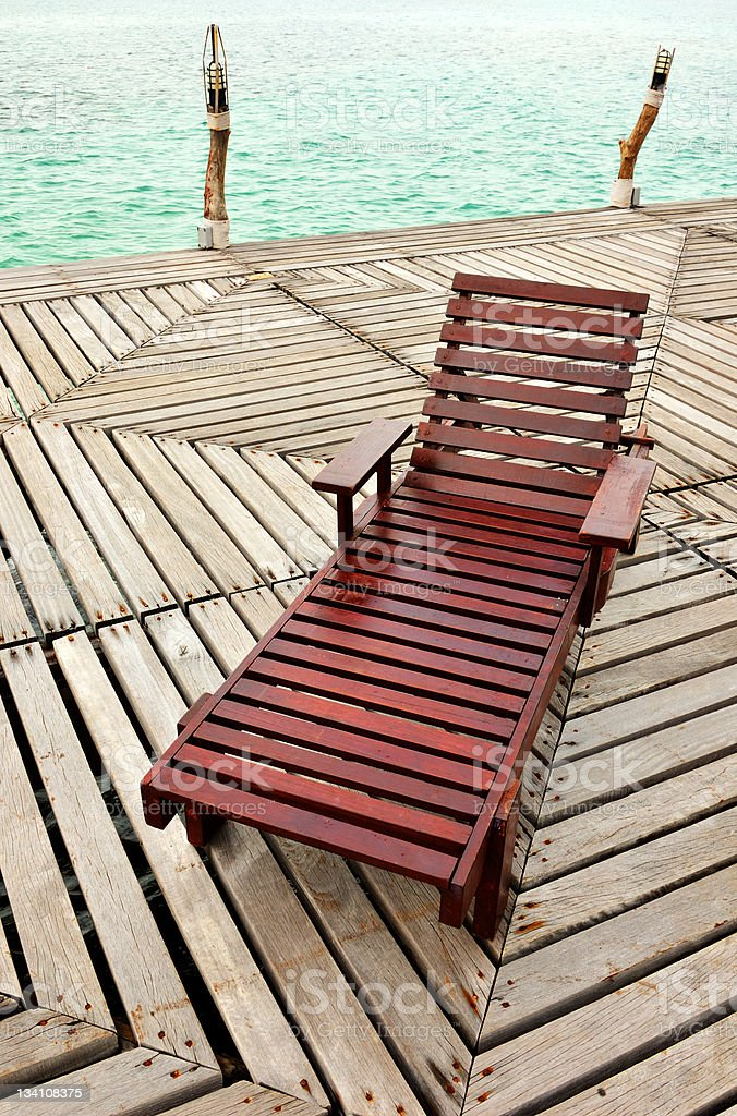 Wooden Chaise Longue On The Dock royalty-free stock photo