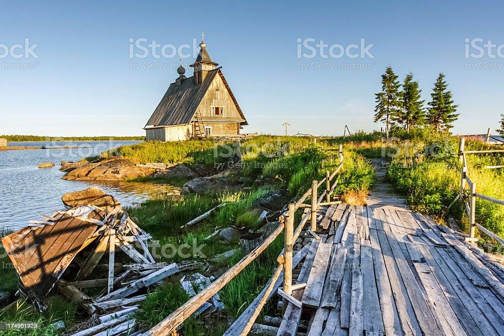 Wooden chapel on sea shore stock photo