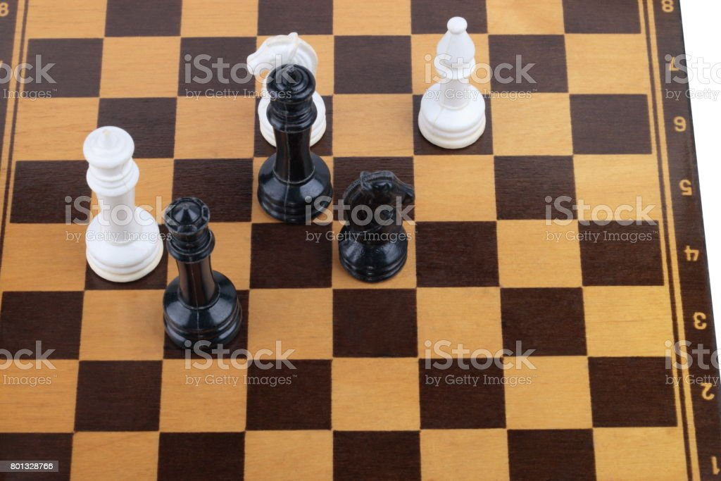 wooden checkerboard with figures stock photo