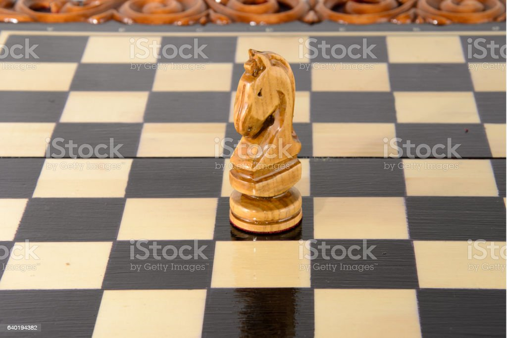 Wooden chess. Black and White Knight stock photo