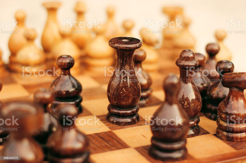 Wooden chess board with the king in focus stock photo