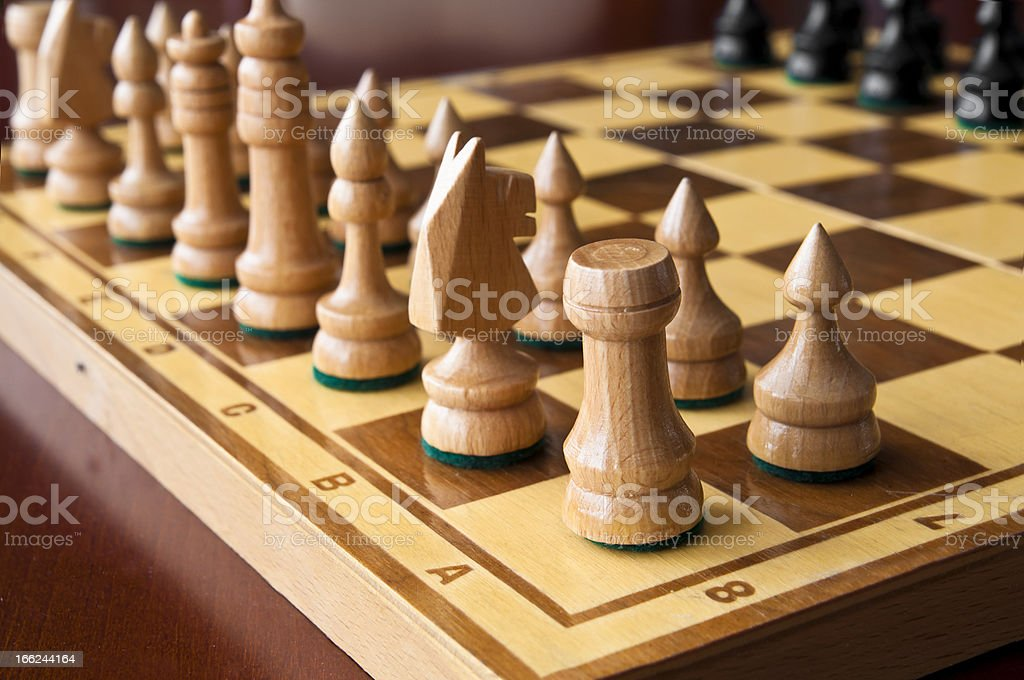 Wooden chess figurines royalty-free stock photo