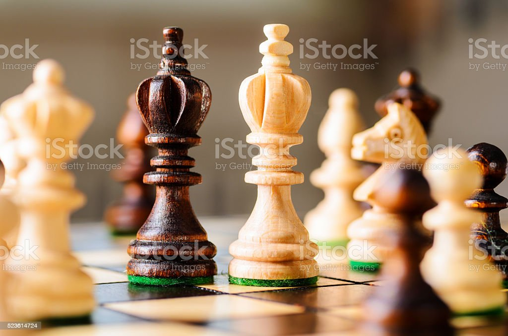 wooden chess pieces stock photo