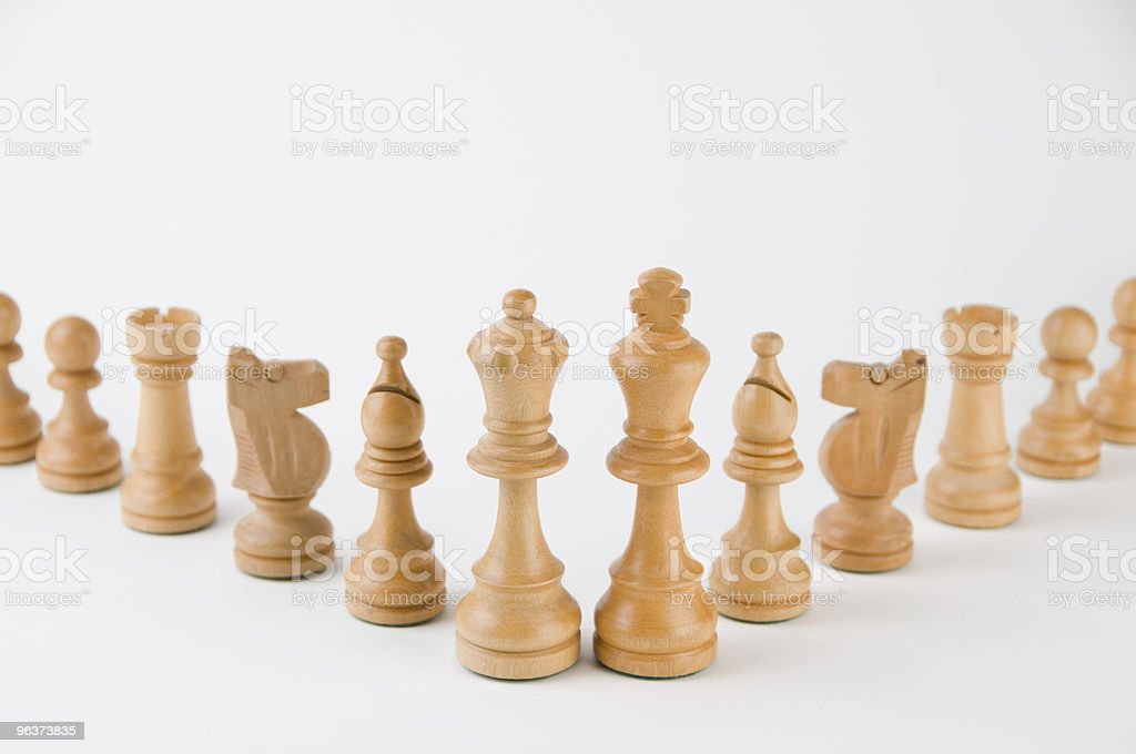 Wooden chess pieces royalty-free stock photo