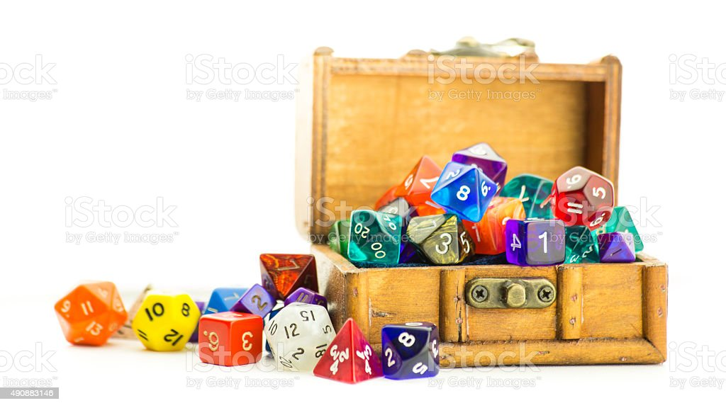 Wooden chest overflows with dice stock photo