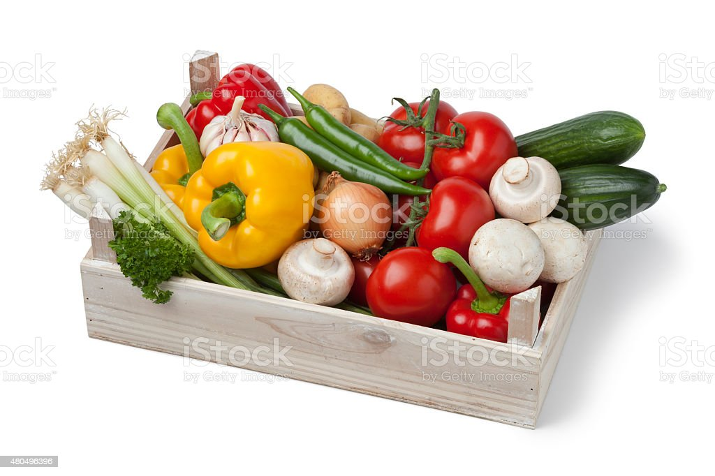 Wooden chest with fresh vegetables stock photo