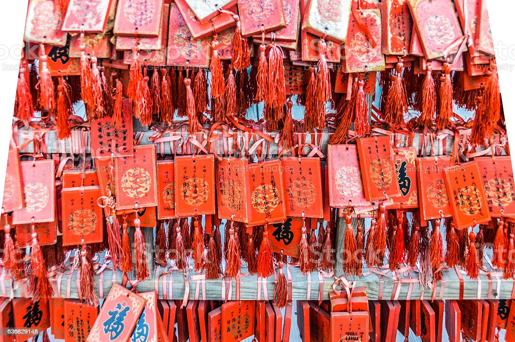 Wooden Chinese prayer tablets with wishes stock photo