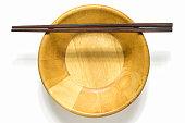 wooden chopsticks and bowl on white background