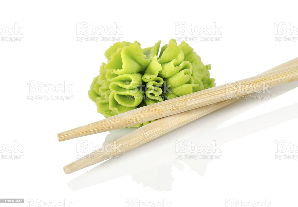 Wooden chopsticks and wasab royalty-free stock photo
