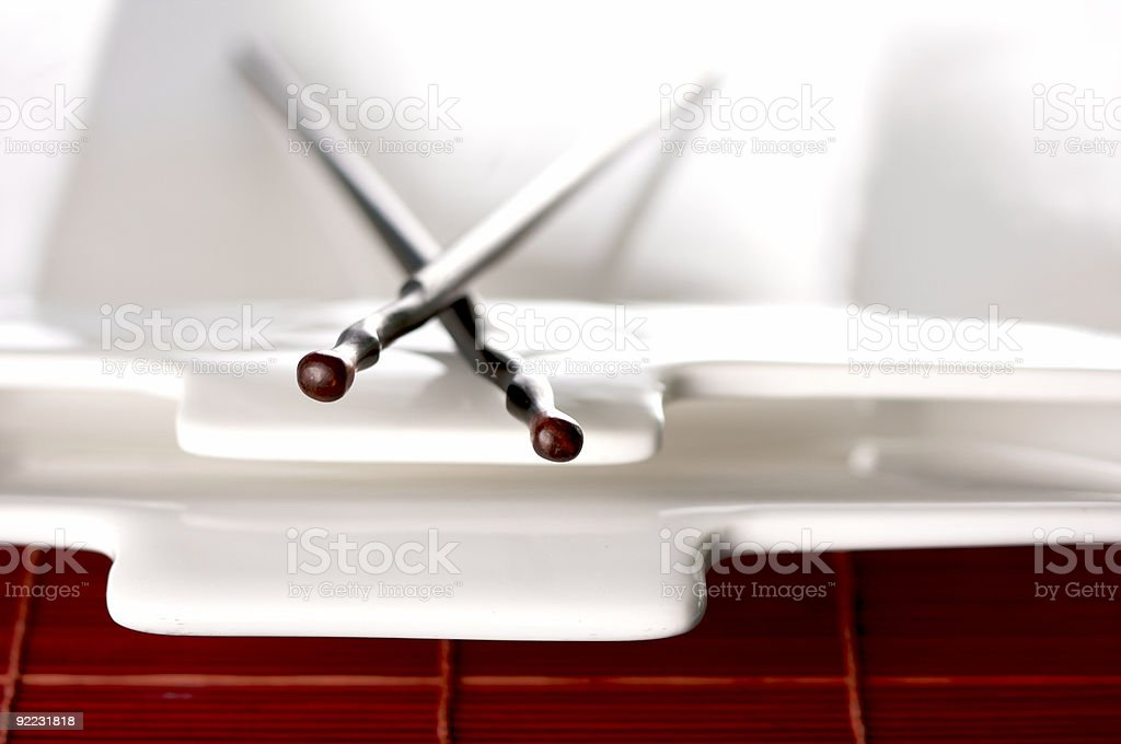 Wooden Chopsticks and White Plate royalty-free stock photo