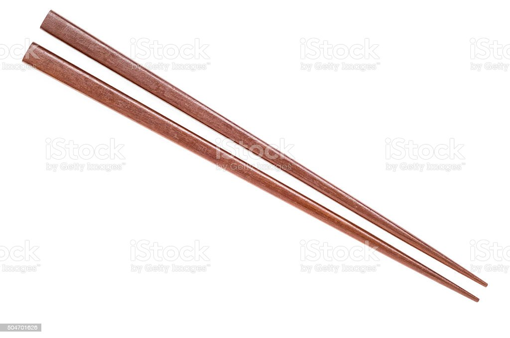 Wooden chopsticks on white background. stock photo