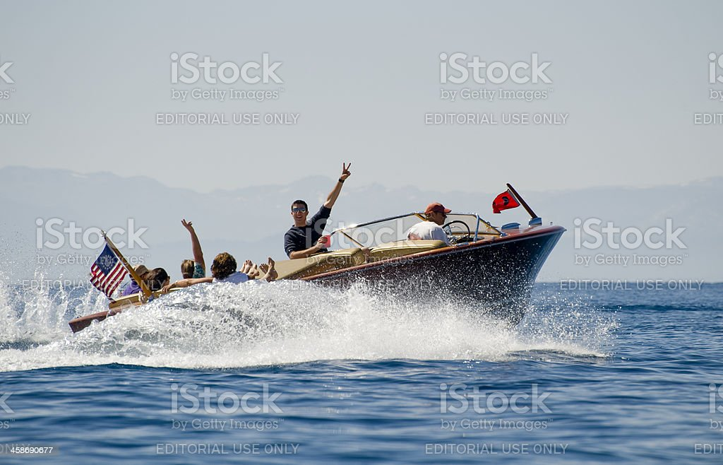 Wooden Chris Craft with Happy Boaters. stock photo