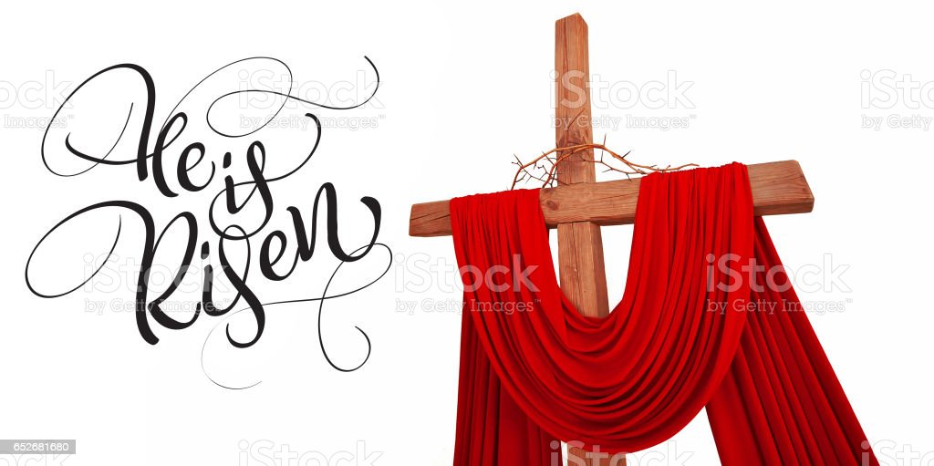 wooden christian cross with crown of thorns and text He is risen. Calligraphy lettering stock photo