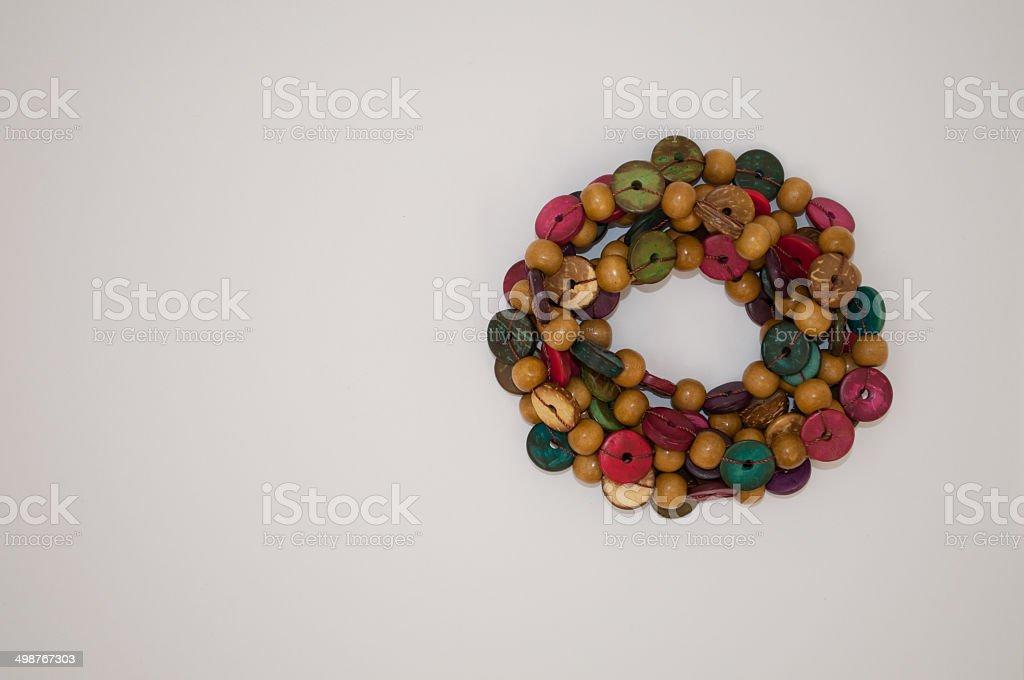 Wooden circle shaped beads on white background stock photo