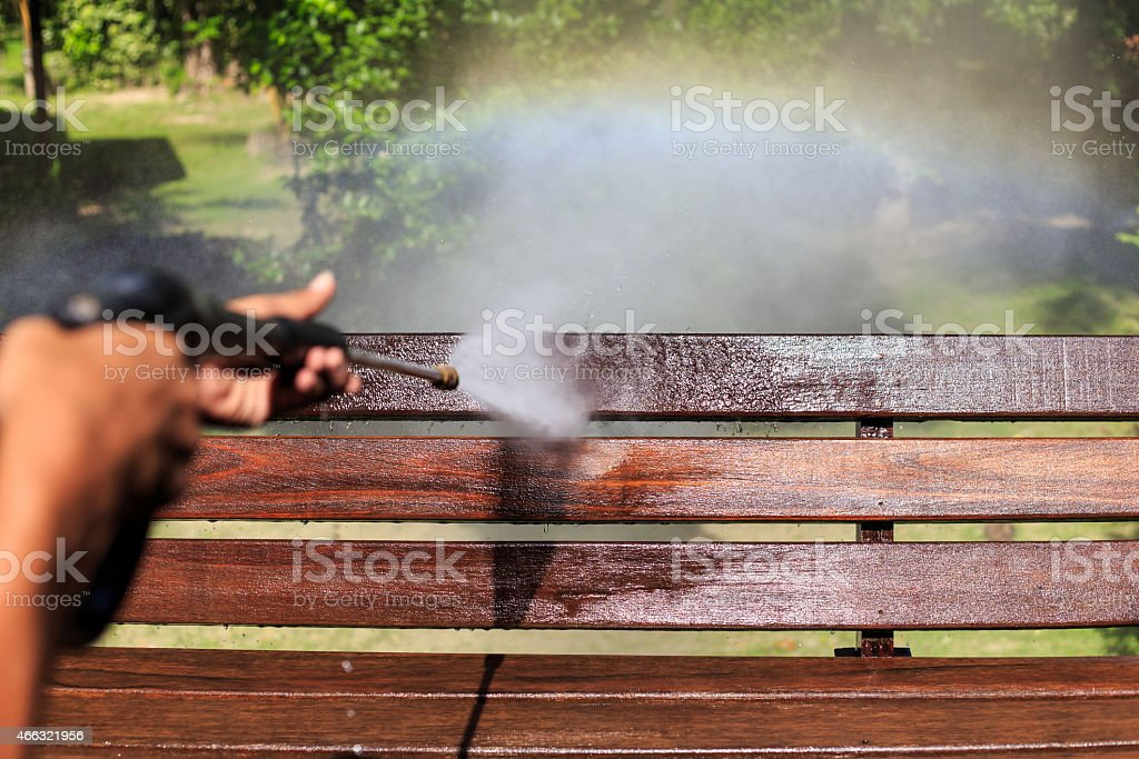 Wooden cleaning with high pressure water jet stock photo