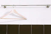 Wooden cloth on stainless steel towel hanger on wall