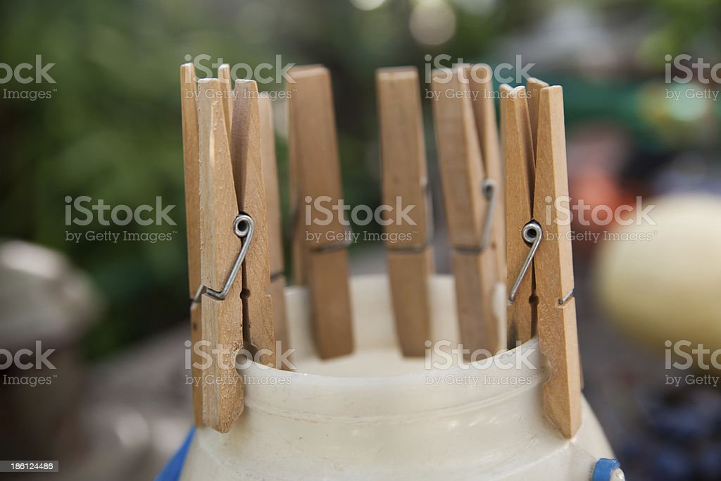 Wooden clothes pins against striped background royalty-free stock photo