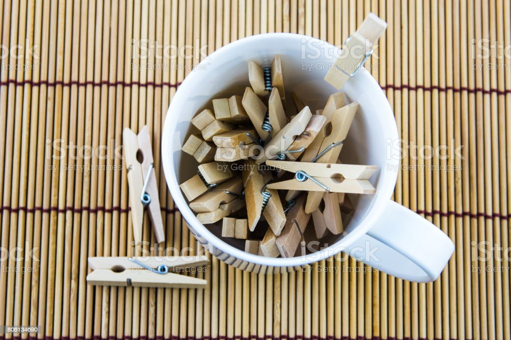 wooden clothespin in glass stock photo