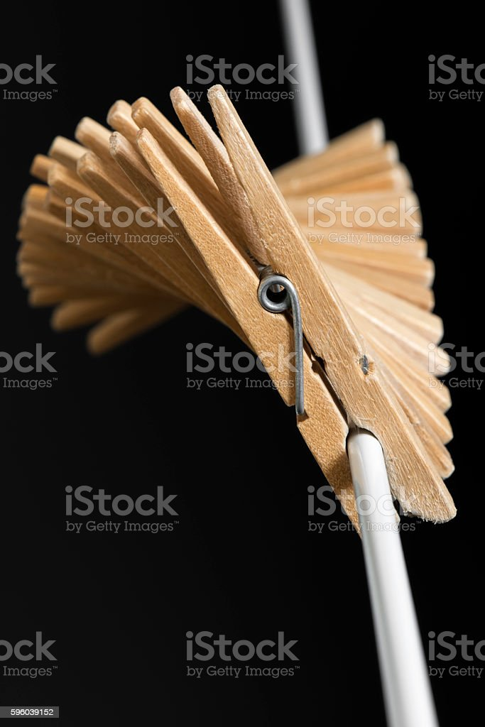 Wooden clothespins to a white thread. stock photo
