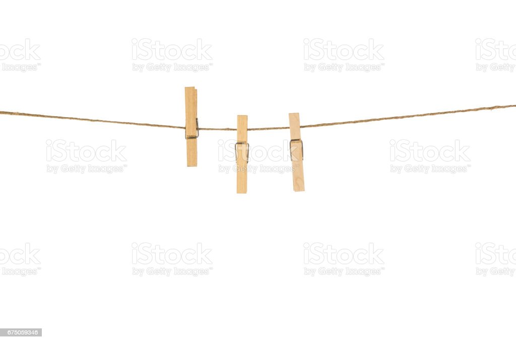 Wooden Clothespins with the rope on a white background stock photo