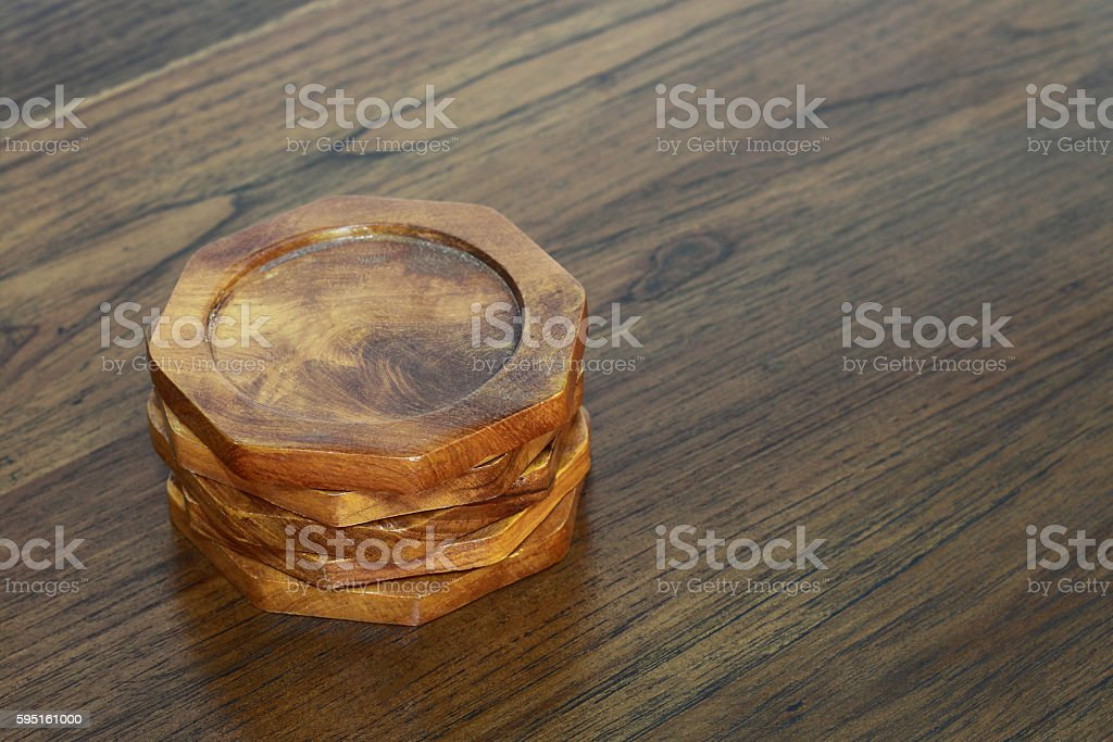 wooden coasters on wooden table stock photo