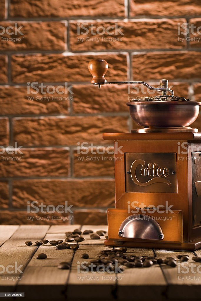 wooden coffee grinder on table royalty-free stock photo