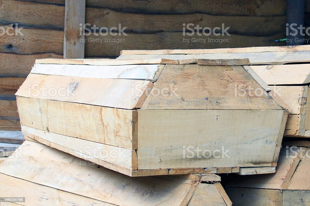 wooden coffins in stock stock photo