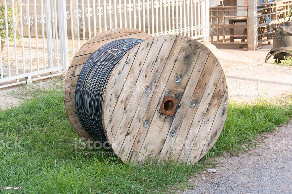 Wooden coil of electric cable stock photo