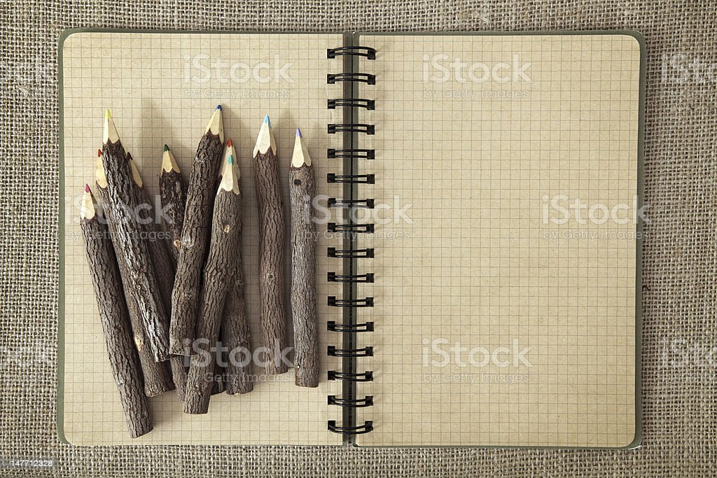 Wooden color pencils and exercise book royalty-free stock photo