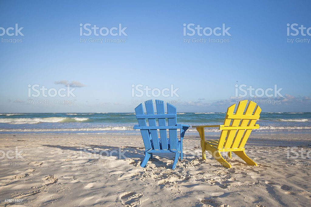 Wooden colorful chairs for vacations on tropical beach stock photo