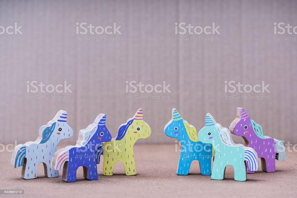 Wooden colorful unicorn horses stock photo