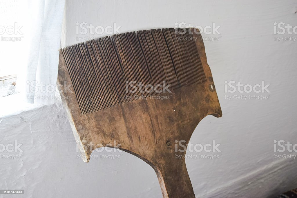 Wooden comb for hair. wool processing stock photo