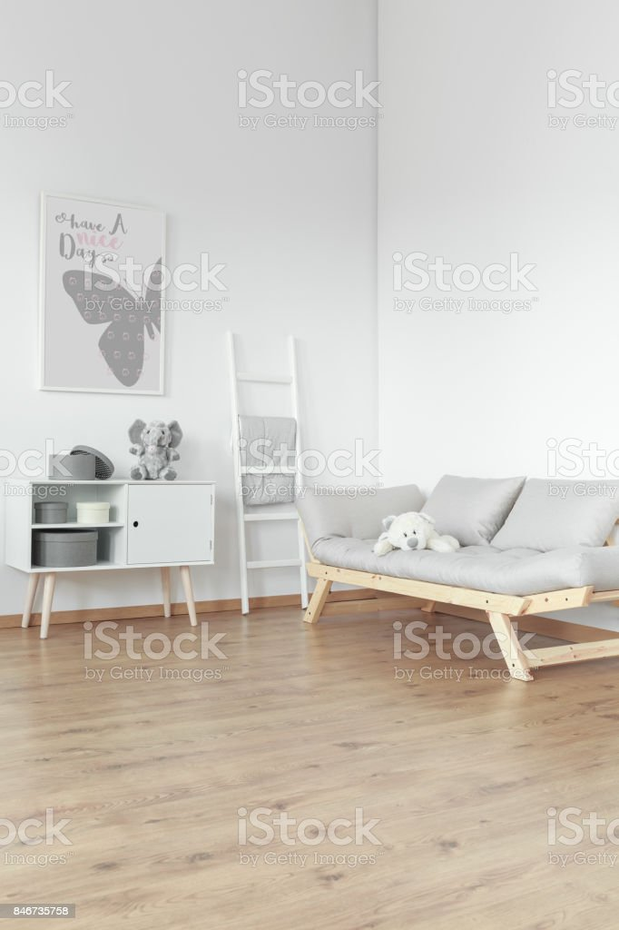 Wooden commode and comfortable sofa stock photo
