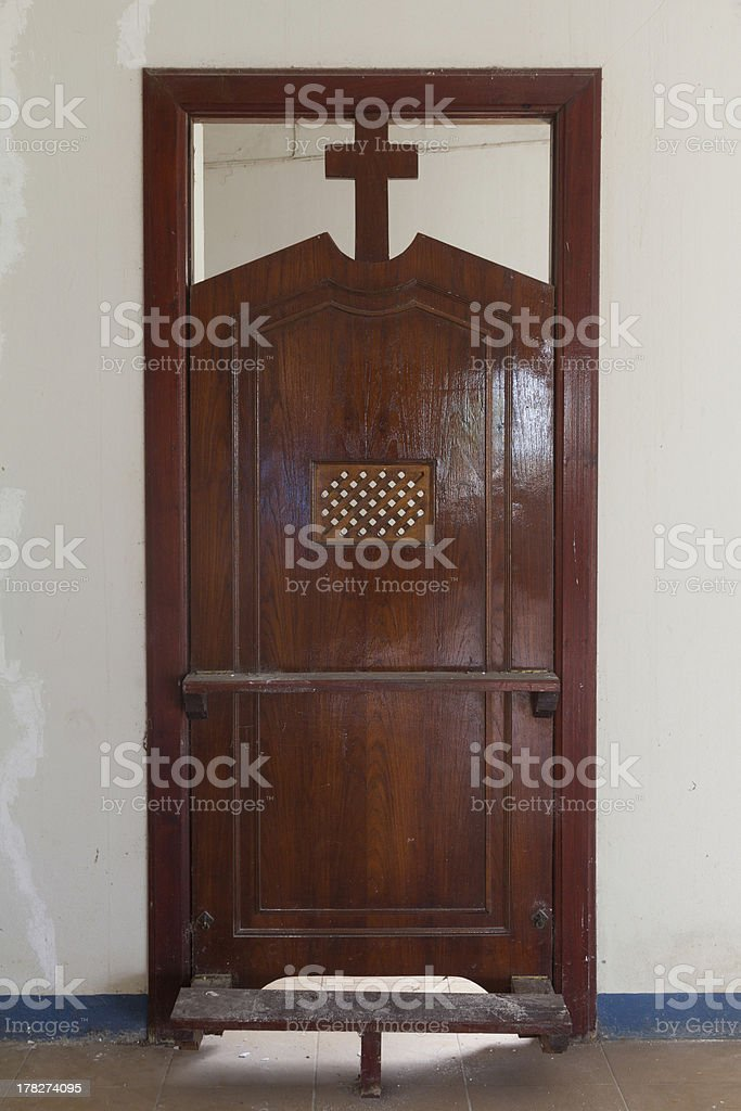 Wooden Confession stock photo