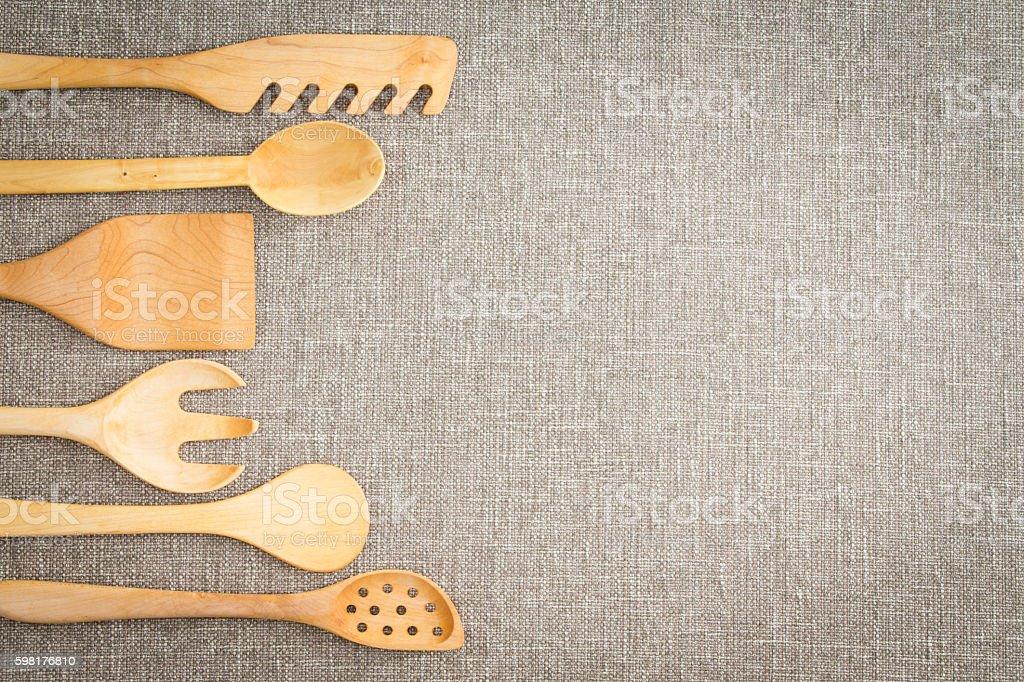 Wooden cooking utensils border stock photo