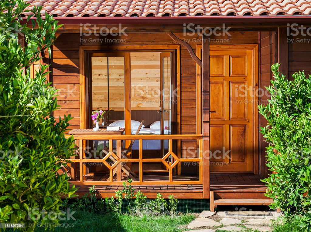 wooden cottage in garden royalty-free stock photo