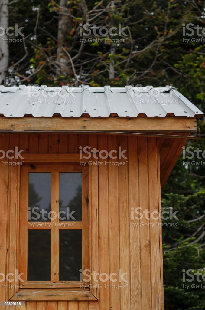 Wooden cottage in the forest stock photo