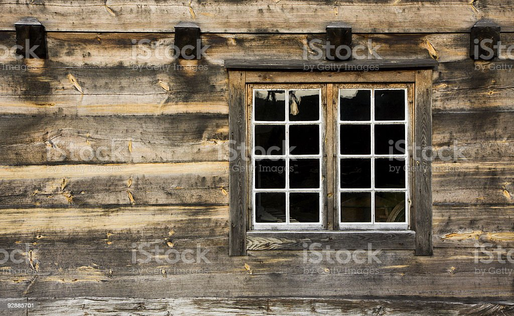 Wooden cottage window in wooden frames stock photo