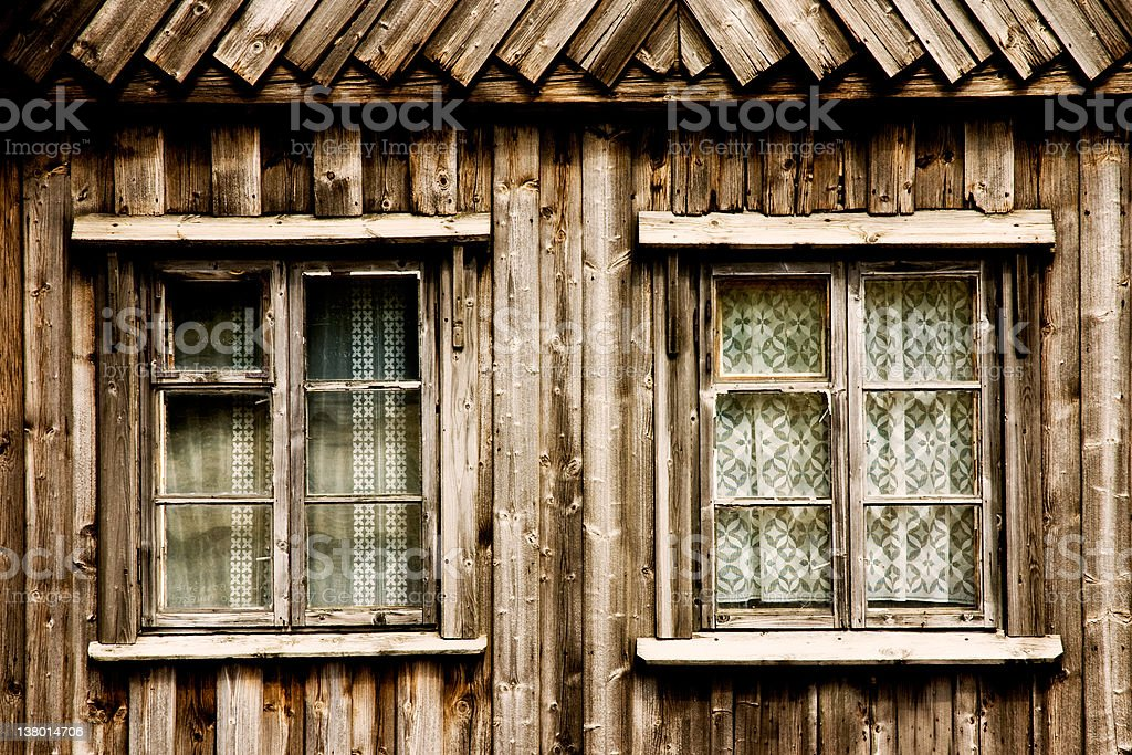 Wooden cottage windows royalty-free stock photo