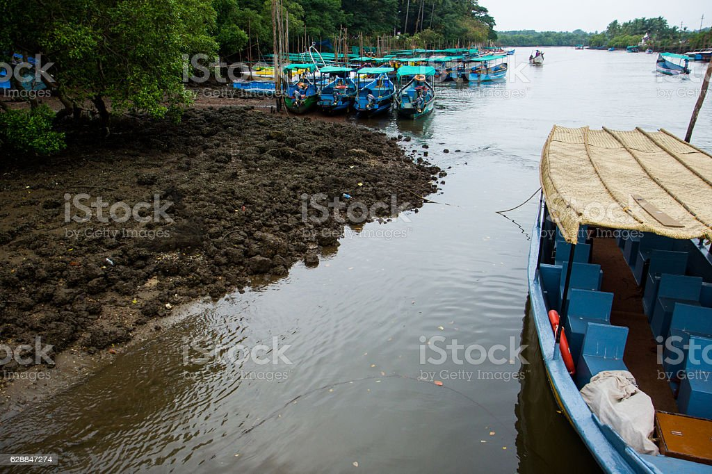 Wooden country boats for pleasure on river Goa, India stock photo