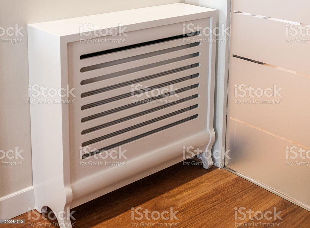 Wooden cover for radiator stock photo