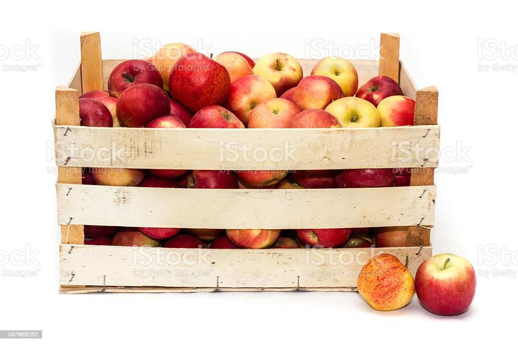 Wooden crate full of apples stock photo