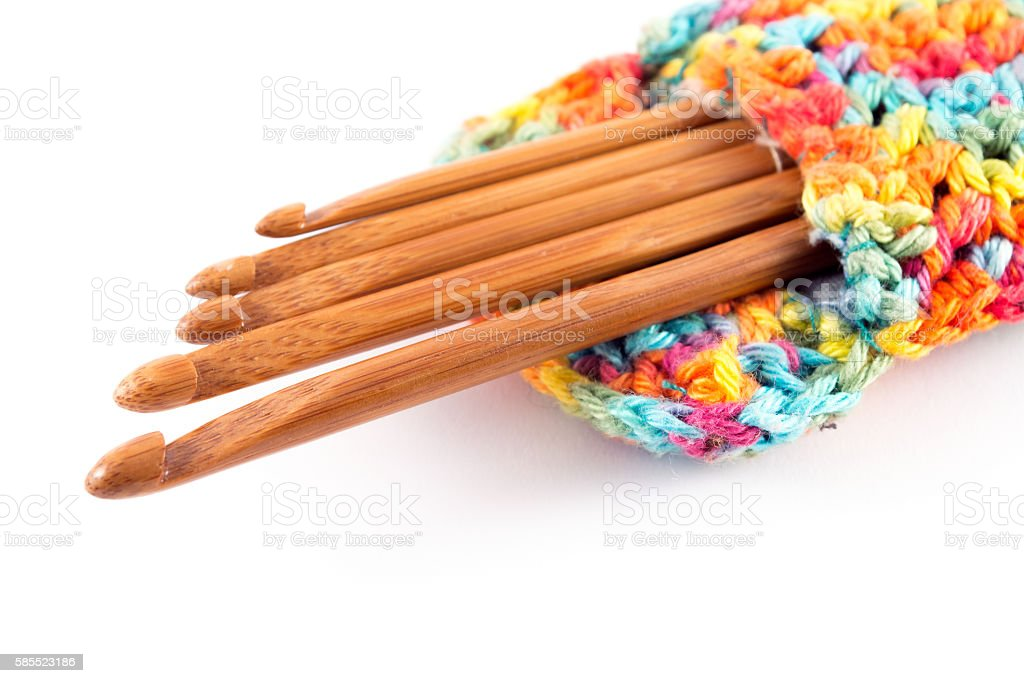 Wooden crochet hooks in colorful bag stock photo