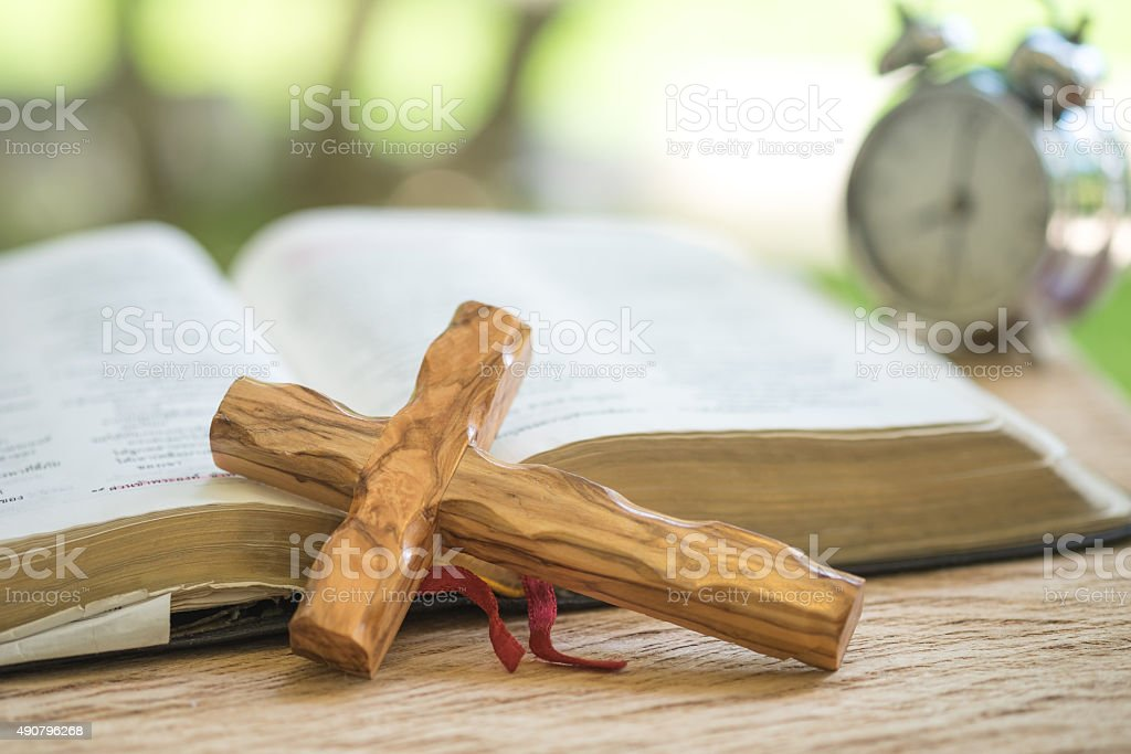 Wooden cross and holy bible stock photo