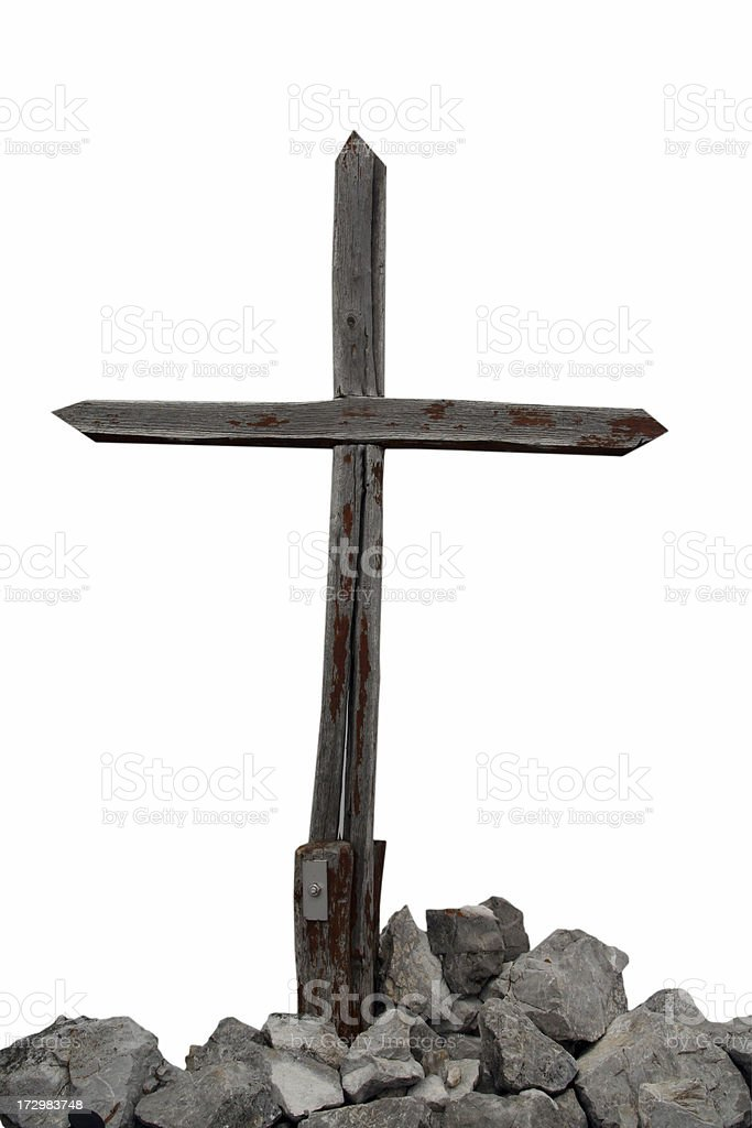 Wooden cross and rocks isolated on white background royalty-free stock photo