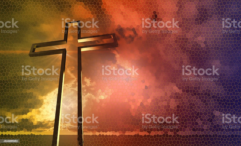 A wooden cross in front of a sunset sky stock photo