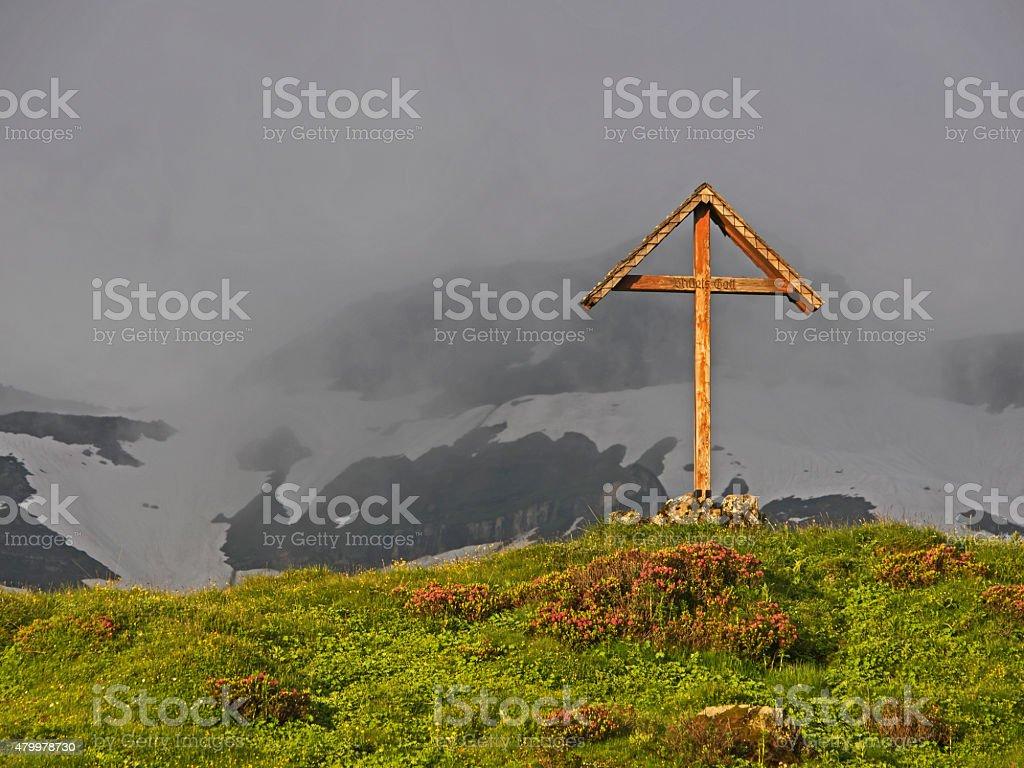 Wooden cross in the morning light, Holzkreuz im morgentlichen Sonnenlicht stock photo