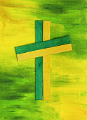 Wooden Cross on a painted green and  yellow background